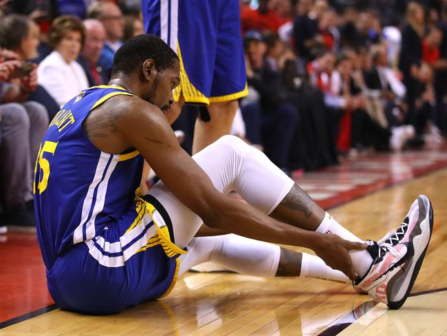 Durant holds his ruptured Achilles. (Photo by Gregory Shamus/Getty)