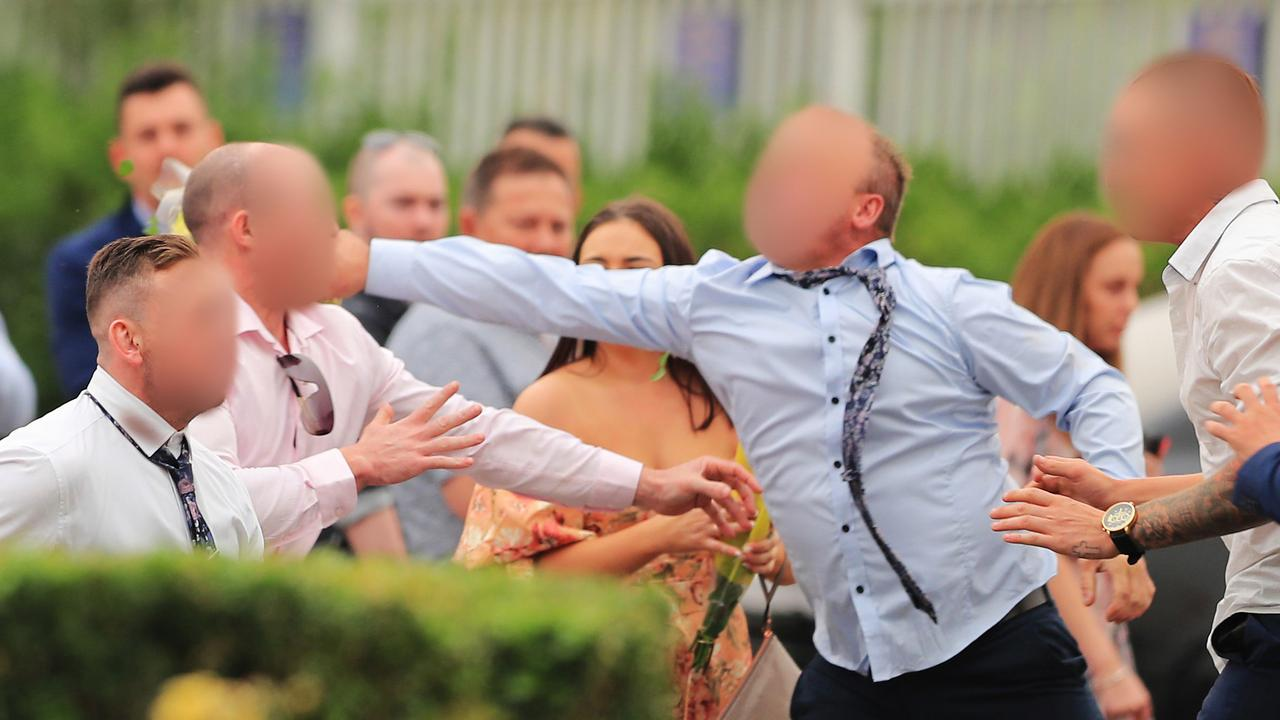 Six men have been charged following a wild brawl at the Rosehill Gardens racecourse on Saturday.