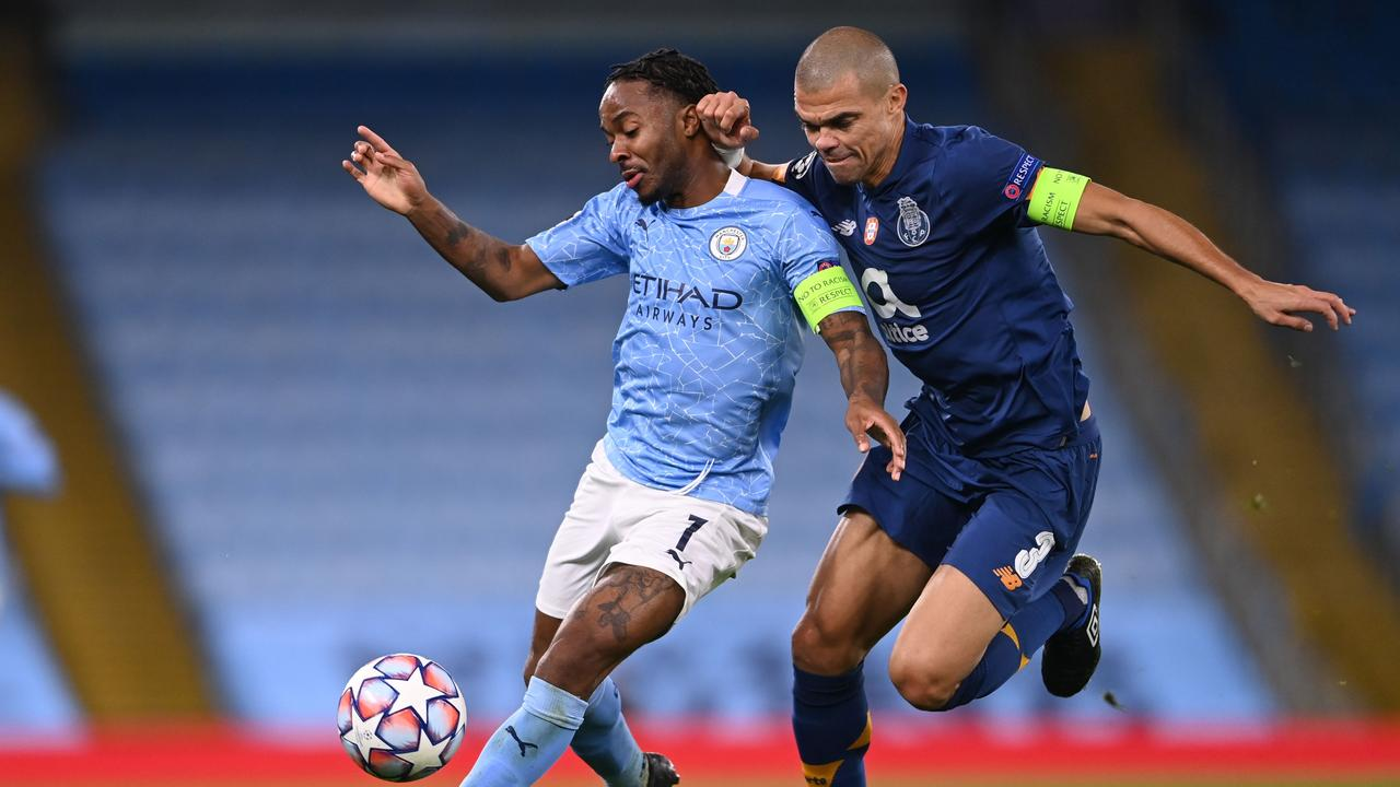 Manchester City's English midfielder Raheem Sterling (L) vies with Porto's Portuguese defender Pepe (R).