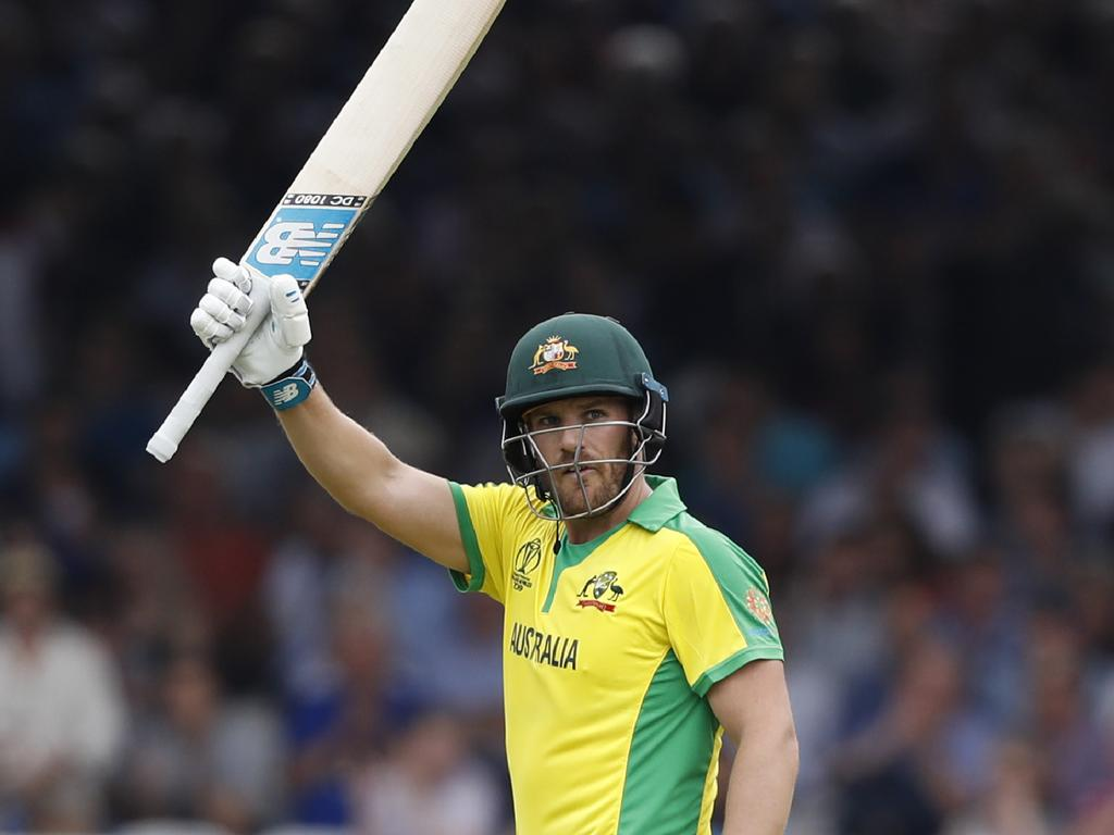 Australia's captain Aaron Finch celebrates after getting 50 runs not out during their Cricket World Cup match between England and Australia at Lord's cricket ground in London, Tuesday, June 25, 2019. (AP Photo/Alastair Grant)