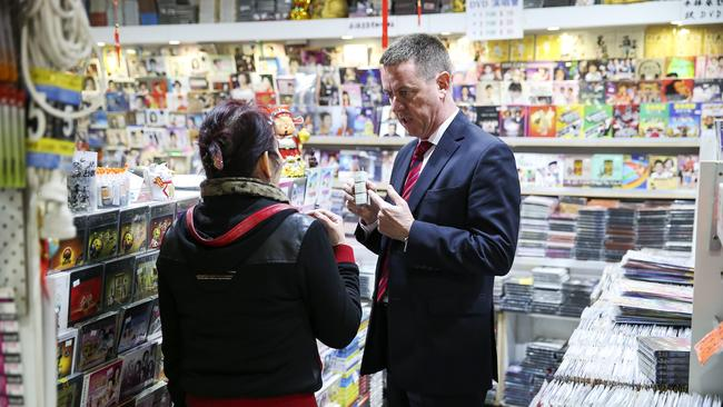 Fair Trading assistant commissioner John Tansy at DVD shop Fashion Rich in China Town that is selling un-approved electrical devices. Picture: Justin Lloyd