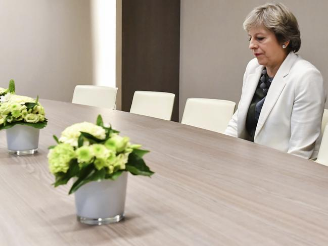 Theresa May waits for the arrival of European Council President Donald Tusk during an EU summit in Brussels. Picture: AP Photo/Geert Vanden Wijngaert, Pool