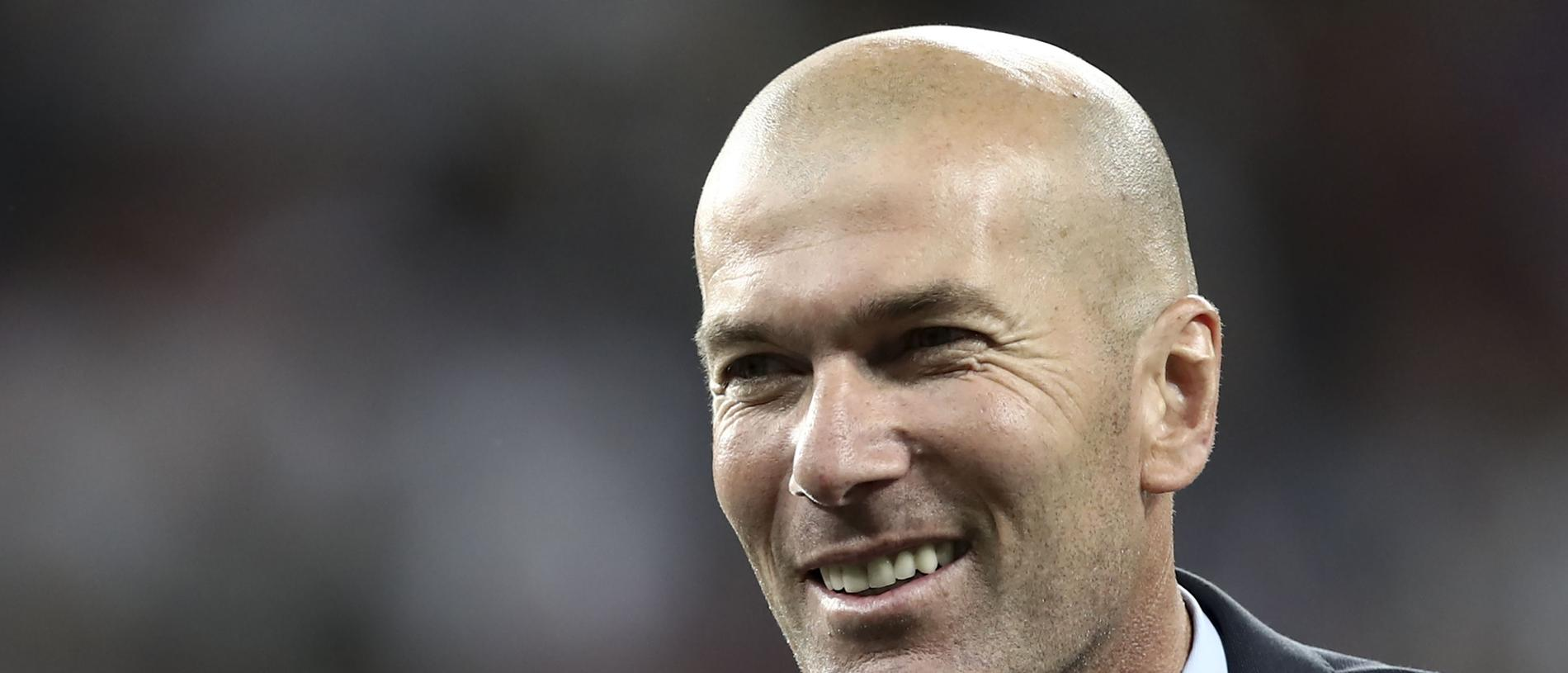 (FILES) In this file photo taken on May 26, 2018 Real Madrid's French coach Zinedine Zidane celebrates after winning the UEFA Champions League final football match between Liverpool and Real Madrid at the Olympic Stadium in Kiev, Ukraine. Real Madrid coach Zinedine Zidane said on May 31, 2018 he was leaving the Spanish giants, just days after winning the Champions League for the third year in a row. / AFP PHOTO / Update Images Press / Isabella BONOTTO
