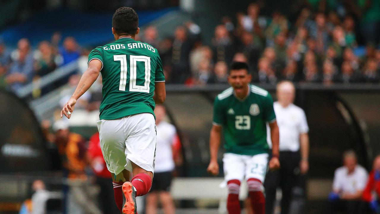Giovani Dos Santos celebrates after scoring against Scotland .