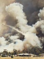 Cassie Groves took this amazing photo of aircraft water bombing a bushfire on Barmaryee Road on Sunday morning.