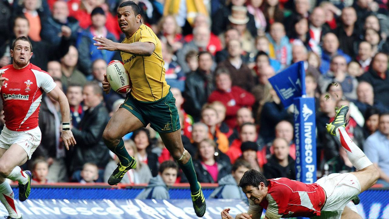 Wallabies star Kurtley Beale breaks through to score a try against Wales in Cardiff in 2010.