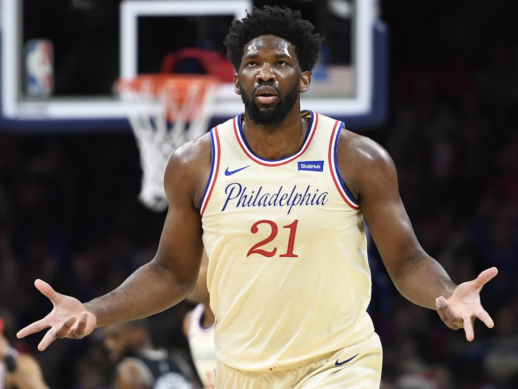 (FILES) In this file photo taken on December 25, 2019, Joel Embiid of the Philadelphia 76ers reacts after scoring during the first half of the game against the Milwaukee Bucks in Philadelphia, Pennsylvania. NOTE TO USER: User expressly acknowledges and agrees that, by downloading and or using this photograph, User is consenting to the terms and conditions of the Getty Images License Agreement.   Sarah Stier/Getty Images/AFP - Embiid returned to full workouts on January 24, 2020, with the NBA club and will be re-evaluated Monday, three weeks after undergoing surgery for a torn left ringfinger ligament. The 25-year-old Cameroonian 7-footer will miss Saturday's home game against the Los Angeles Lakers but after the evaluation, a team decision announced on the NBA website, he could be back on the court Tuesday when the 76ers face Golden State. (Photo by Sarah Stier / GETTY IMAGES NORTH AMERICA / AFP)