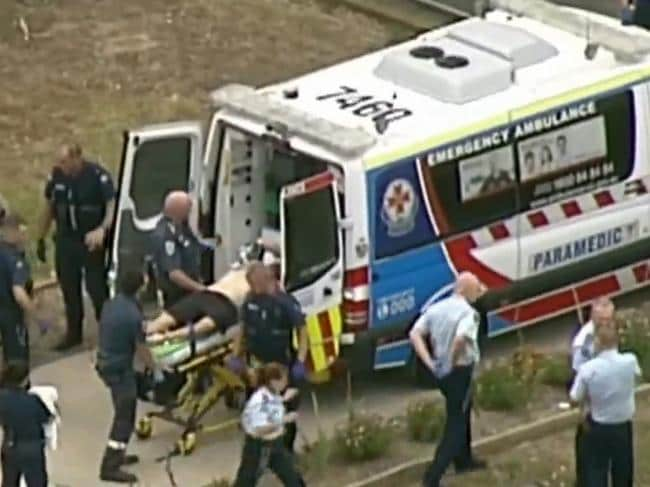 Paramedics work on a critically injured Tony Mokbel at Barwon prison. Picture: Seven News