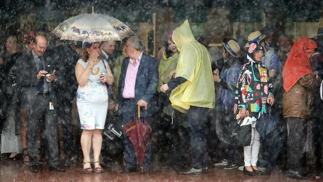 Crowds are hiding from the saturating rain. Picture: Alex Coppel