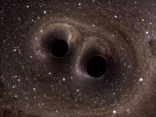Two black holes merge into one and produce gravitational waves. Picture: YouTube