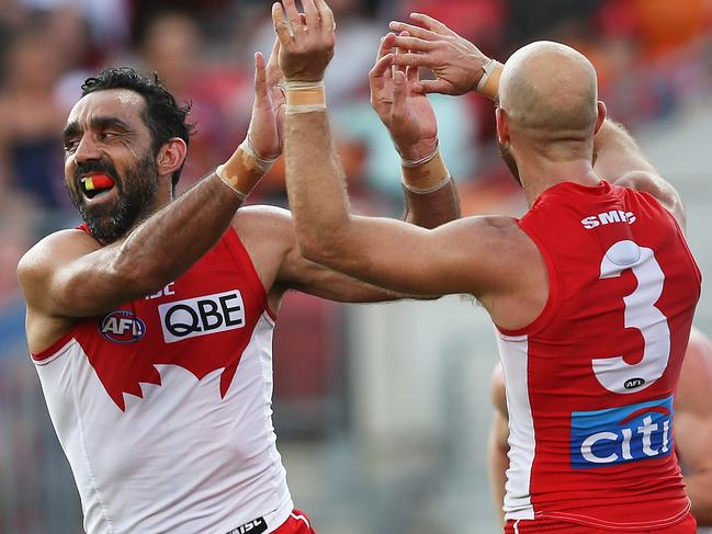 Adam Goodes celebrates a goal with Jarrad McVeigh.