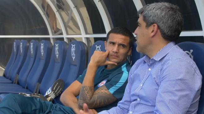 Tim Cahill in his new club merchandise.
