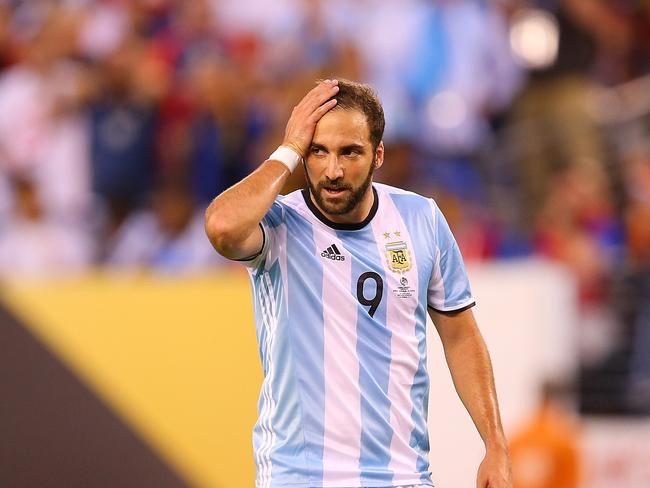 Gonzalo Higuain #9 of Argentina reacts after missing a late chance against Chile.