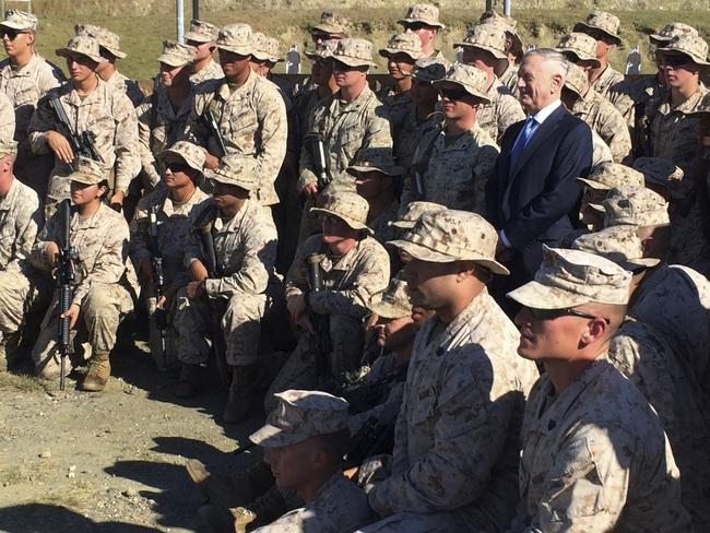 Defence Secretary Jim Mattis with U.S. Marine Corps troops at a rifle range at Guantánamo Bay, Cuba. Picture: AP