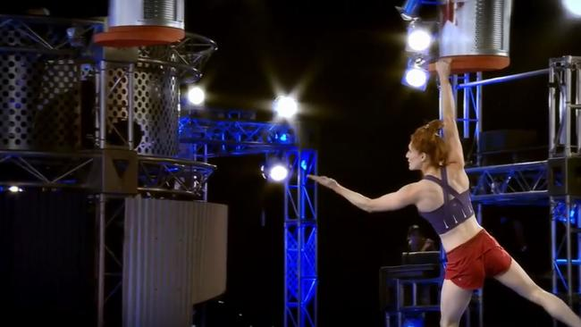 Olivia blows a kiss during the Hanging Shelf obstacle.