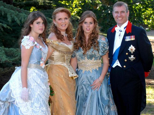 Princess Beatrice, 2nd right, is joined by sister, Princess Eugenie, left, and parents the Duke and Duchess of York, before an 1888 themed masked ball at Windsor Castle. Picture: Mark Stewart/PA