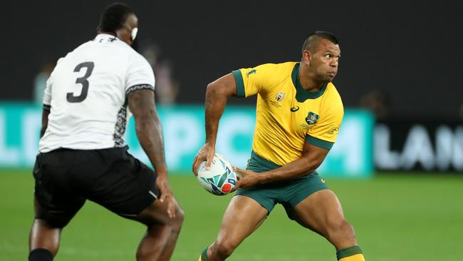 Beale spins the ball wide during Australia's first-up victory over Fiji. Picture: Getty