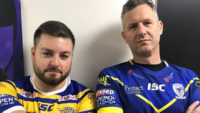 The Last Leg's Alex Brooker and Adam Hills in Leeds and Warrington jerseys.