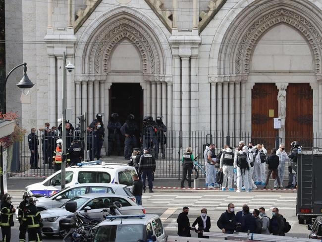 French members of the elite tactical police unit RAID enter to search the Basilica of Notre-Dame de Nice. Picture: Valery Hache/AFP