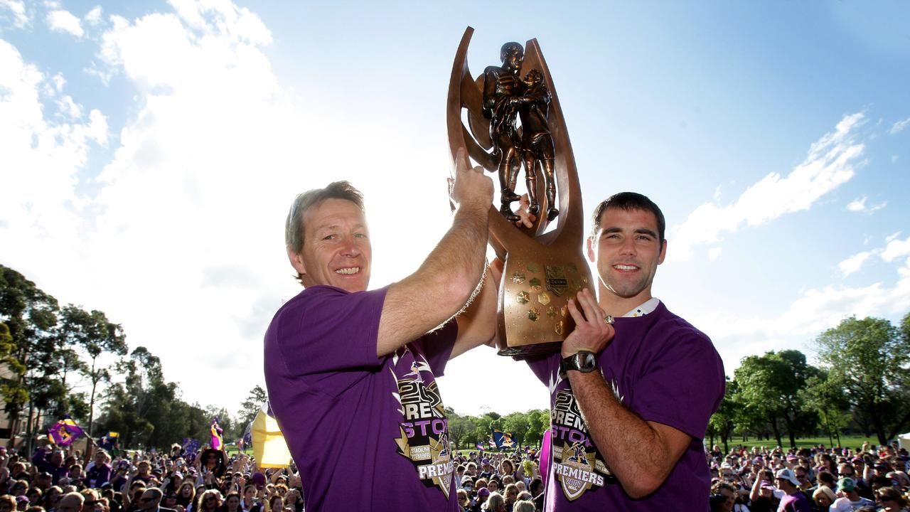 Storm coach Craig Bellamy with Cameron Smith holding their first NRL premiership trophy at Princes Park in Carlton, Melbourne 01 Oct 2007.