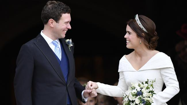 Look of love. Princess Eugenie and Jack Brooksbank leave St George's Chapel after their wedding. Picture: Toby Melville, Pool via AP