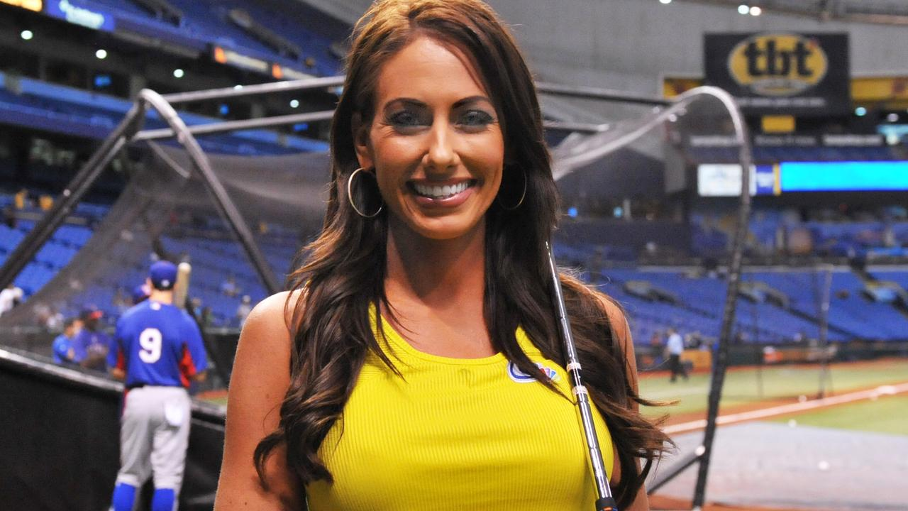 Golfer Holly Sonders poses before throwing out a ceremonial first pitch as the Tampa Bay Rays host the Texas Rangers in 2013.