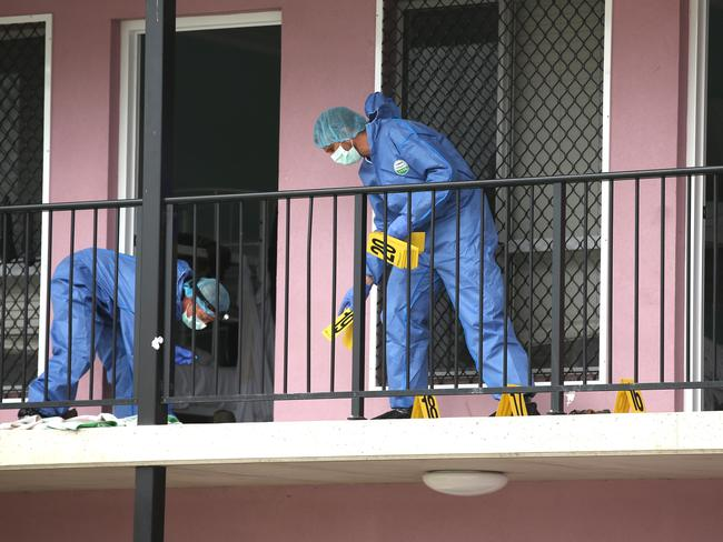 Forensic police examine the scene where Ms Ayliffe-Chung died. Lyndon Mechielsen/The Australian