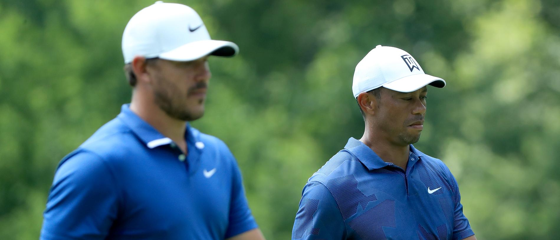 DUBLIN, OHIO - JULY 17: Tiger Woods of the United States and Brooks Koepka of the United States walk during the second round of The Memorial Tournament on July 17, 2020 at Muirfield Village Golf Club in Dublin, Ohio. (Photo by Sam Greenwood/Getty Images)
