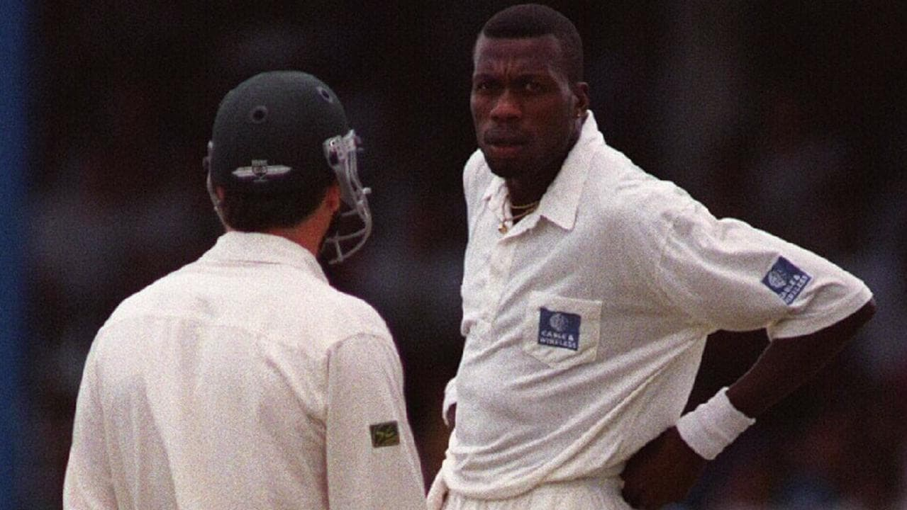 Curtly Ambrose gives Steve Waugh a look.
