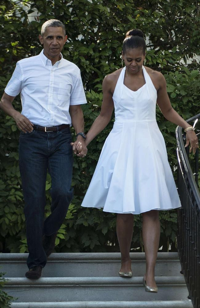 No comment ... US President Barack Obama and First Lady Michelle Obama walk to an Independence Day celebration at the White House.