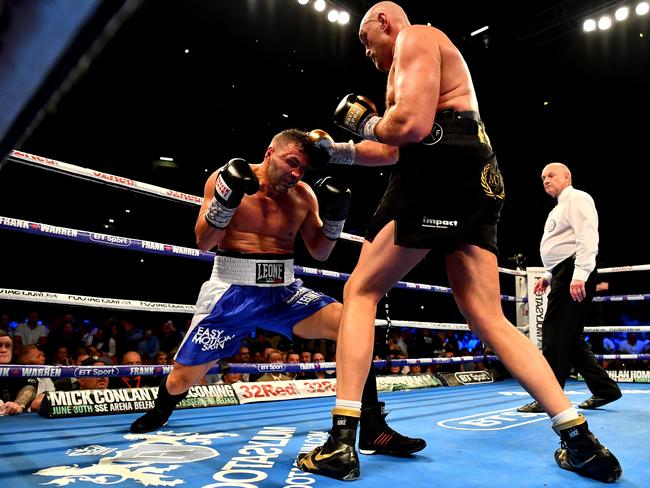Tyson Fury punches Sefer Seferi during there heavyweight contest at Manchester Arena.