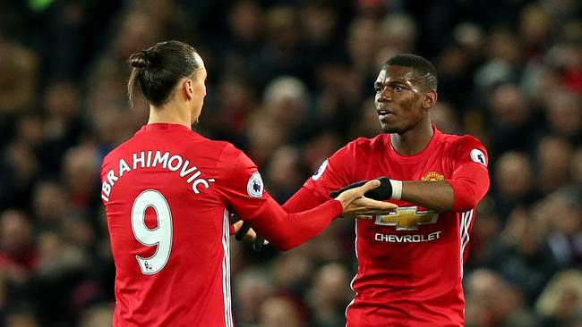 Zlatan Ibrahimovic of Manchester United (L) speaks to Paul Pogba.