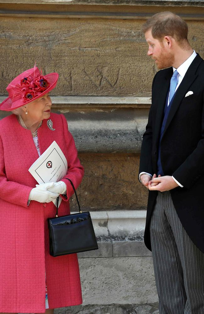 Harry, right, joined his grandmother Queen Elizabeth at St George's Chapel for the wedding of Lady Gabriella Windsor and Thomas Kingston. Picture: AFP