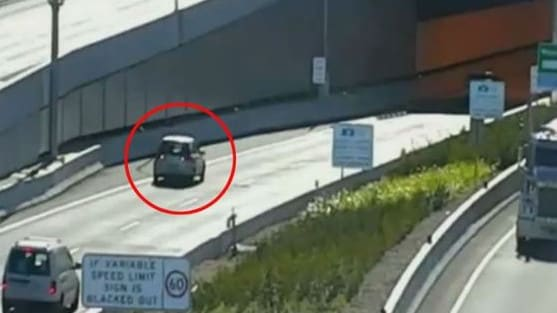 This car begins to slowly reverse out of the tunnel. Picture: Channel 9