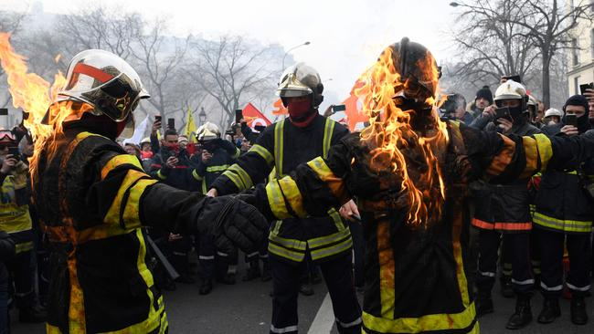 Firefighters set themselves on fire. Picture: Bertrand Guay / AFP