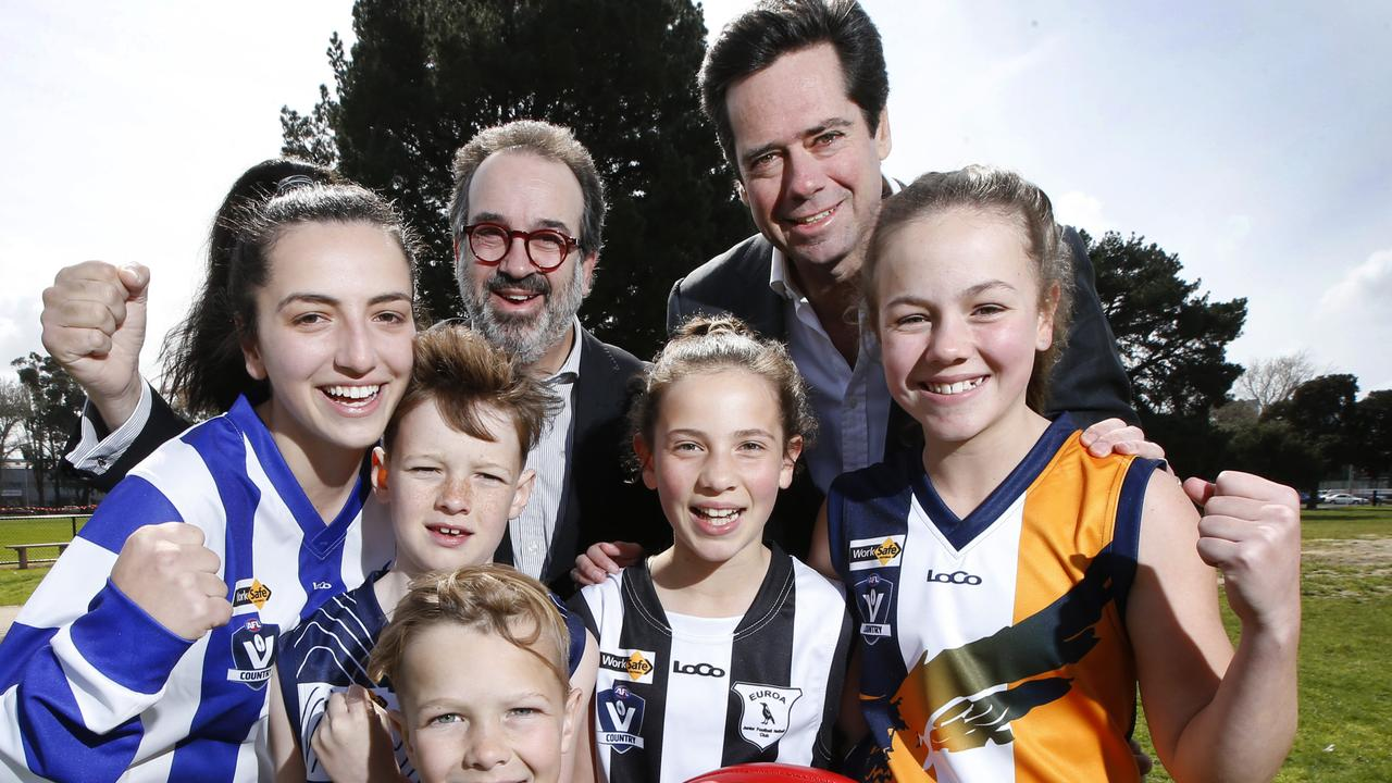 AFL chief executive Gillon McLachlan and Sports Minister Martin Pakula with country football kids Alexandra, Tom, Jaska, Coco and Jasmine. Picture: David Caird