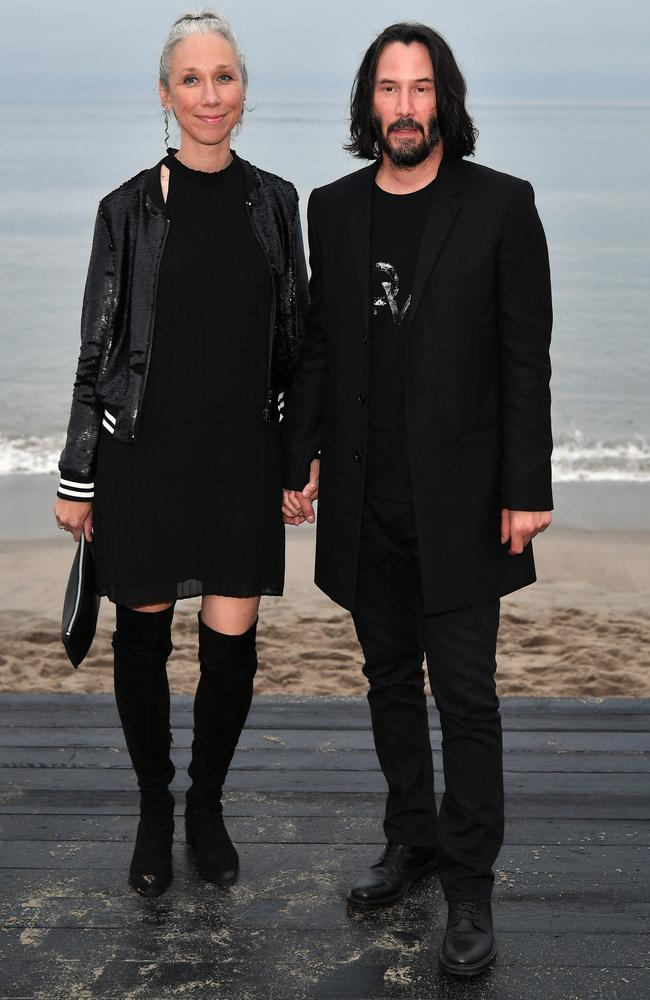 The fashionable pair looked loved-up at a Saint Laurent runway show this year. Picture: Getty Images.