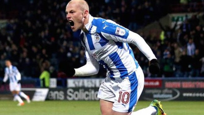 Aaron Mooy celebrates his goal.