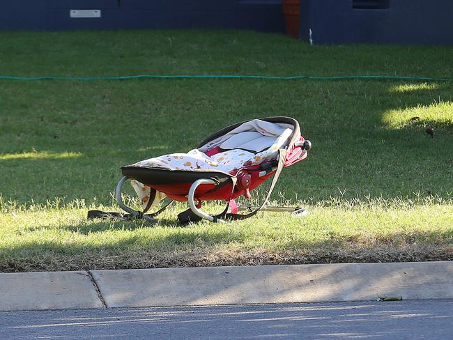 A baby's bassinet sits in a yard in the Parkinson street. Picture: Marc Robertson