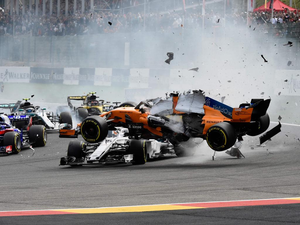 BEST NEWS PICTURES OF 2018 -  -- AFP PICTURES OF THE YEAR 2018 --  McLaren's Spanish driver Fernando Alonso crashes during the Belgian Formula One Grand Prix at the Spa-Francorchamps circuit in Spa on August 26, 2018. (Photo by JOHN THYS / AFP)
