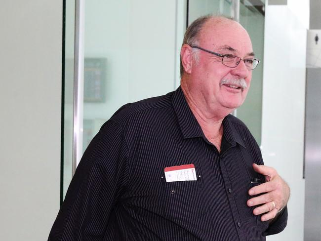 Talking to the PM ... Warren Entsch arrives at Canberra Airport this afternoon. Picture: Ray Strange