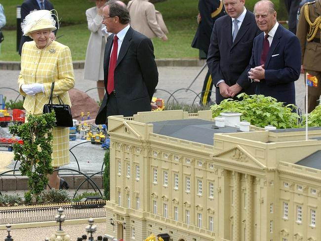 Queen Elizabeth II and Prince Philip check out a model of Buckingham Palace at Legoland in 2003. Picture: AP/PA, Matthew Fearn