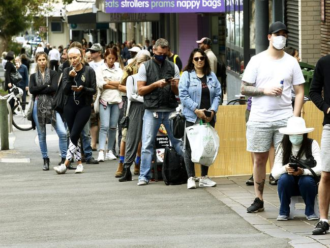 Not many people practised social distancing in the large queue from the Centerlink office in Bondi Junction on Monday. Picture: John Appleyard