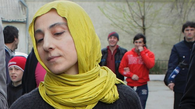 ALTERNATIVE CROP OF MOSB107 - Zubeidat Tsarnaeva, mother of Tamerlan and Dzhokhar Tsarnaev, the two men accused of setting off bombs near the Boston Marathon finish line on April 15, 2013 in Boston, walks near her home in Makhachkala, Dagestan, southern Russia, Tuesday, April 23, 2013. The Tsarnaev brothers are accused of setting off the two bombs at the Boston Marathon on April 15 that killed three people and wounded more than 200. Tsarnaev, 26, was killed in a gun battle with police. His 19-year-old brother, Dzhokhar Tsarnaev, was later captured alive, but badly wounded. (AP Photo/Ilkham Katsuyev)