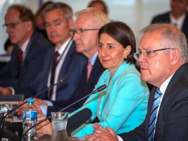 The Premier of New South Wales Gladys Berejiklian listens as Australian Prime Minister Scott Morrison speaks during the Meeting of the Council of Australian Governments. Picture: AFP