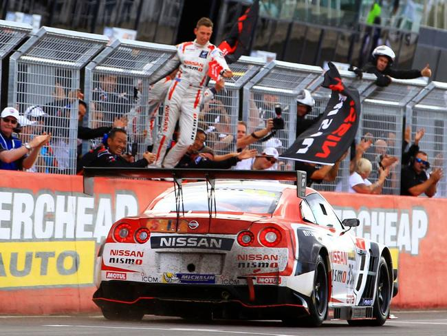 Florian Strauss congratulating his teammate after winning the Bathurst 12 Hour.