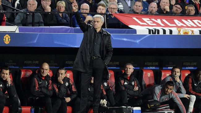 Manchester United's Portuguese coach Jose Mourinho (C) gives instructions