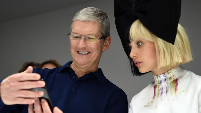 Apple CEO Tim Cook shows off the latest iPhone to dancer Maddie Ziegler. Picture: AFP/Josh Edelson