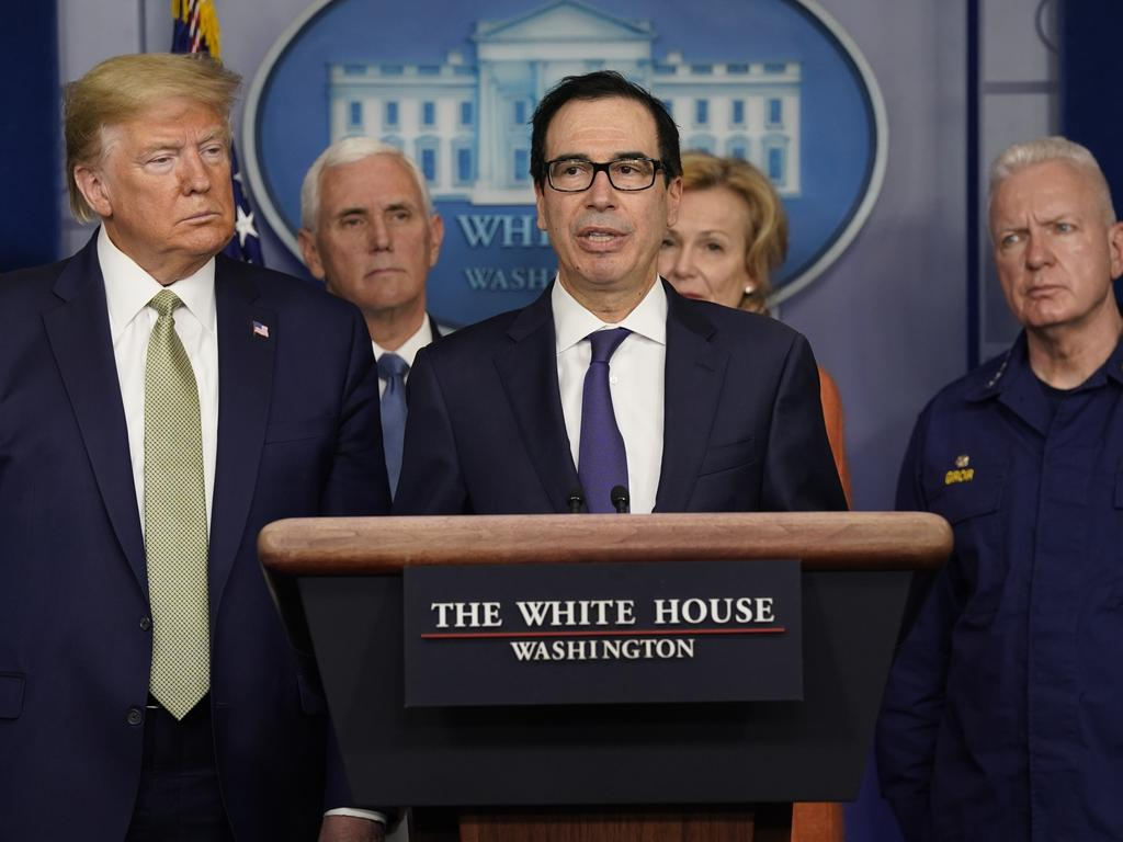 Treasury Secretary Steven Mnuchin speaks during a press briefing as US President Donald Trump looks on. Picture: AP