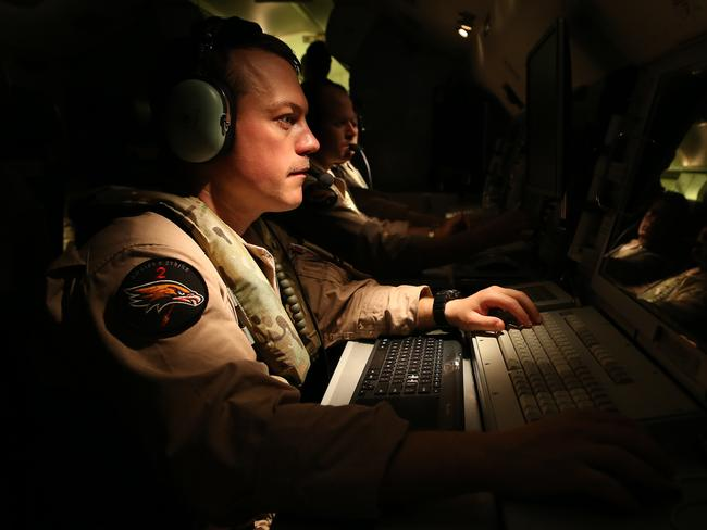 Combat mission ... Flight Lieutenant Daniel White, a senior systems control officer in the Royal Australian Air Force, prepares for a mission on a E-7A Wedgetail aircraft over the Middle East. Picture: Supplied